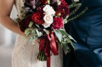18 a luxurious wedding bouquet in the shads of red, deep purple and white with eucalyptus and red ribbons
