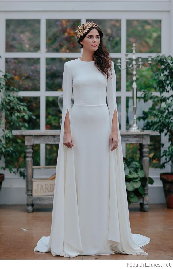 a plain fitting wedding dress with a high neckline and creative long sleeves for a modenr or minimalist bride
