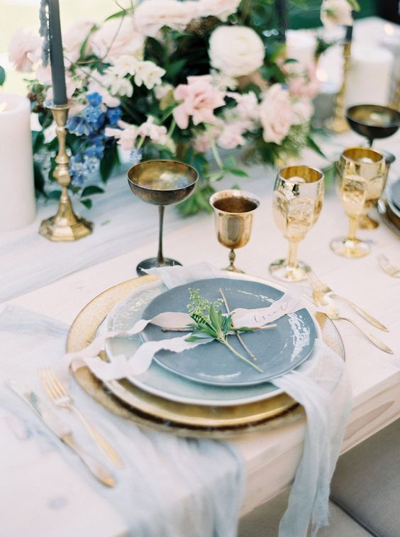 gold glasses and goblets, gold cutlery and chargers plsu candle holders for exquisite wedding table decor