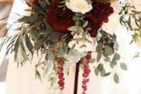 19 a bright and textural winter wedding bouquet with burgundy, blush and white flowers and lots of greenery