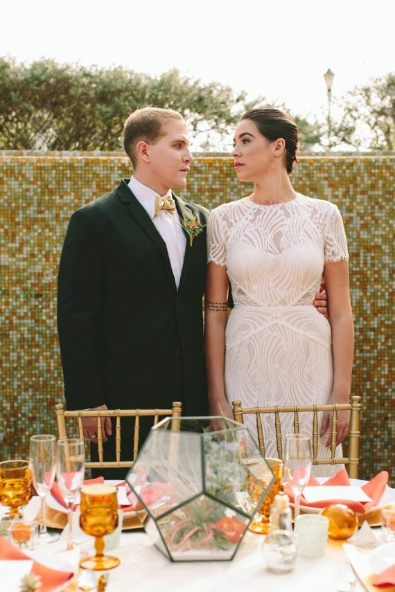 a modern fitting geometric wedding gown with short sleeves and an illusion neckline plus sheer sides
