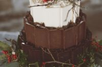 19 a woodland-inspired Christmas wedding cake with dark, milk and white chocolate topped with berries, twigs and pinecones