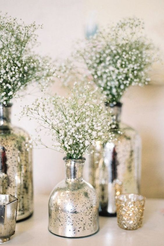 fill mercury vases with baby's breath or other white flowers to add height and texture to tables