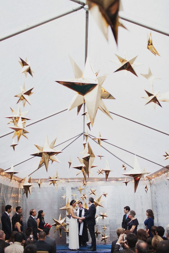 oversized gold stars hanging over the whole ceremony space create a magical ambience and atmosphere, whatever your theme is