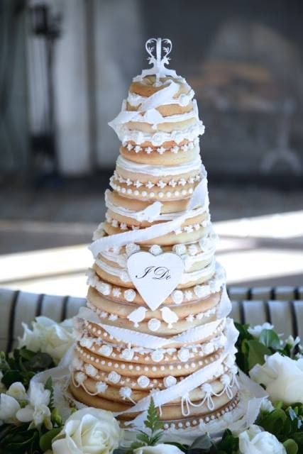 a beautiful kransekake wedding cake decorated with ribbons and creamy touches is a traditional Nordic idea