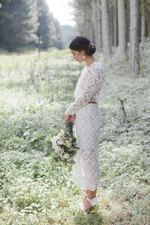 a gorgeous lace bridal separate with a crop top with long sleeves and a high neckline plus a pencil skirt and white shoes