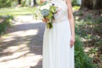 20 a retro-inspired geometric pattern halter neckline wedding dress, patterns are done in pastel shades