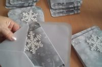 20 silver grey winter wedding invites with snowflakes and in grey envelopes for a trendy look