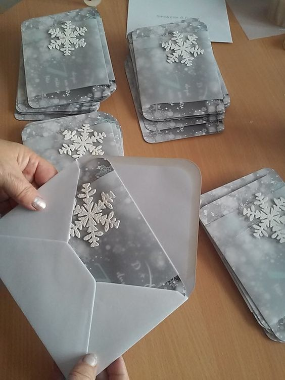 silver grey winter wedding invites with snowflakes and in grey envelopes for a trendy look