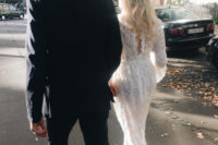 21 a midi boho lace fitting wedding dress with a slit on the back, long sleeves and a cutout