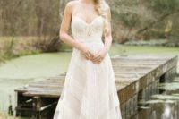 21 a romantic geometric lace wedding gown with a sweetheart neckline and thick straps and an A-line skirt