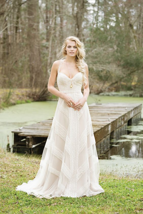 a romantic geometric lace wedding gown with a sweetheart neckline and thick straps and an A line skirt