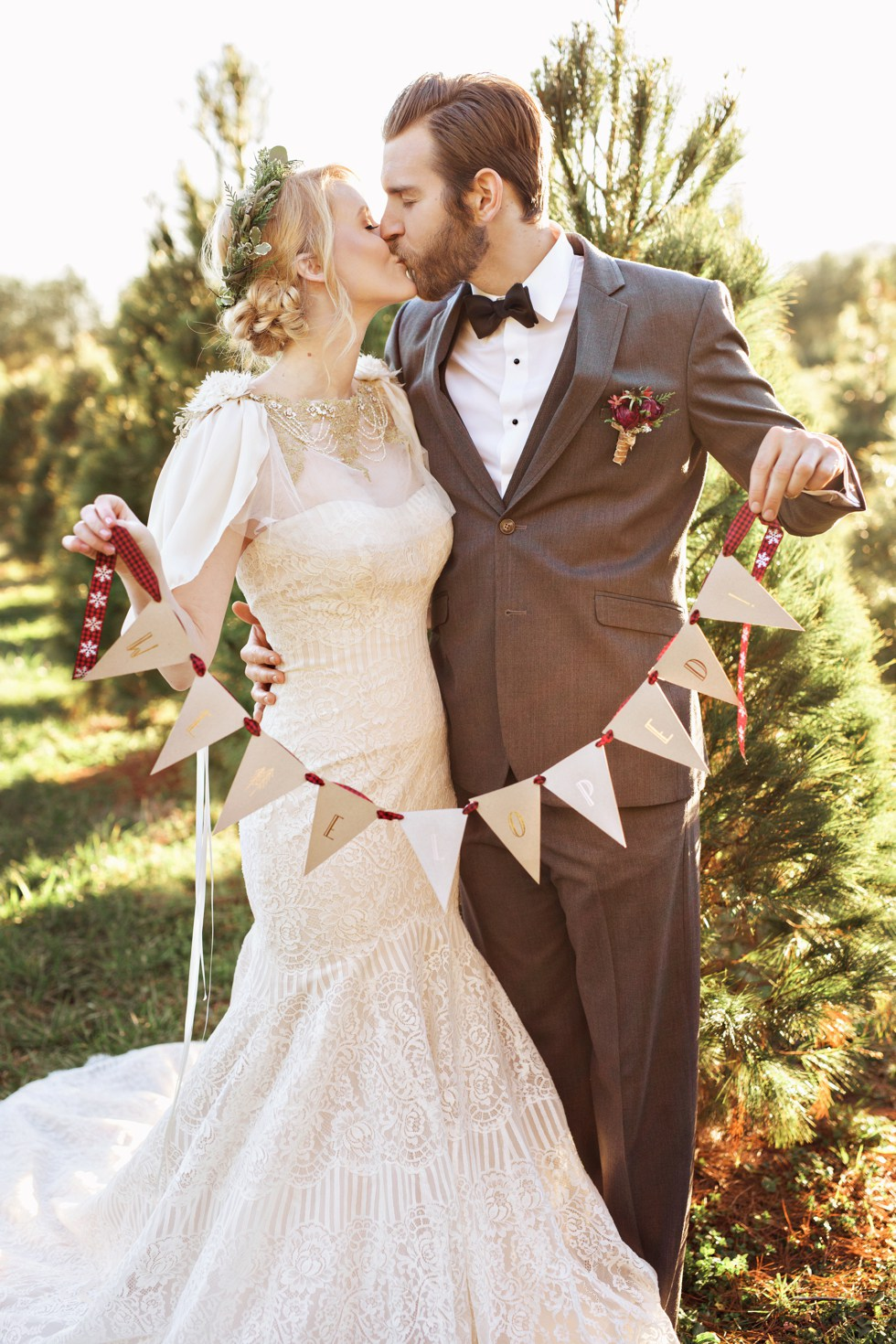 a strapless vintage inspired mermaid lace wedding gown and a decorative coverup with beading and faux fur