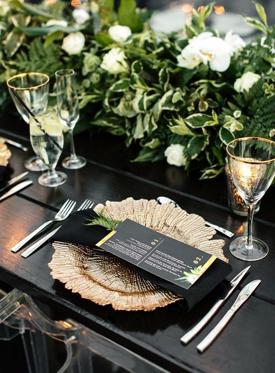 gold rimmed glasses and exquisite gold chargers make the tablescape outstanding and look ideal with any colors