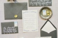 21 grey wedding stationery with whites and calligraphy plus touches of gold is a timelss idea for winter