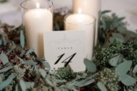 21 seeded eucalyptus and some candles will make up a cool centerpiece for any wedding, not only a winter one