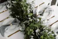 22 a textural greenery wedding runner with much foliage and evergreens plus grey napkins
