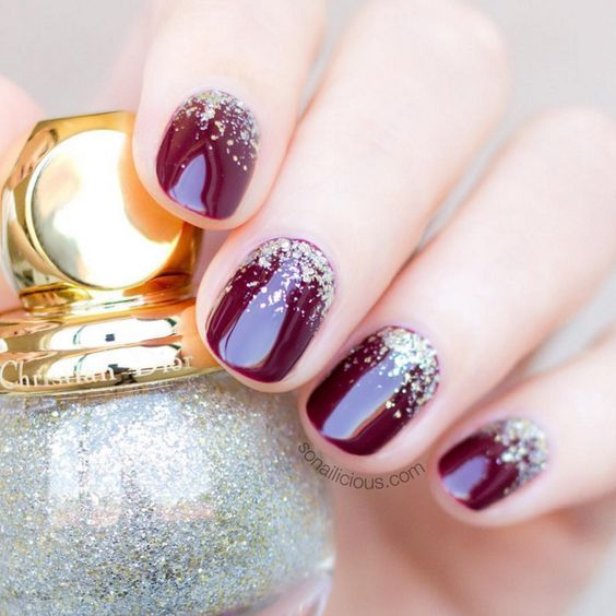 burgundy nails with gold glitter are always good for winter or winter holidays weddings