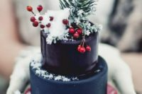 23 a mini Christmas wedding cake in navy and deep purple, topped with berries and evergreens to make a statement with color