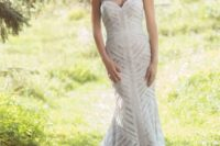 23 a strapless mermaid wedding dress with a geometric pattern, embellishments and a train for a very romantic bride