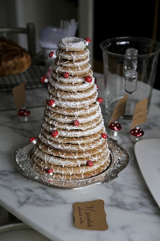 a kransekake with little edible mushrooms is a fun idea for any woodland wedding and a great altenative to a usual cake