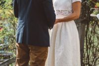 24 a romantic lace two piece wedding dress with a high low midi skirt and a crop top is ideal for a boho bride