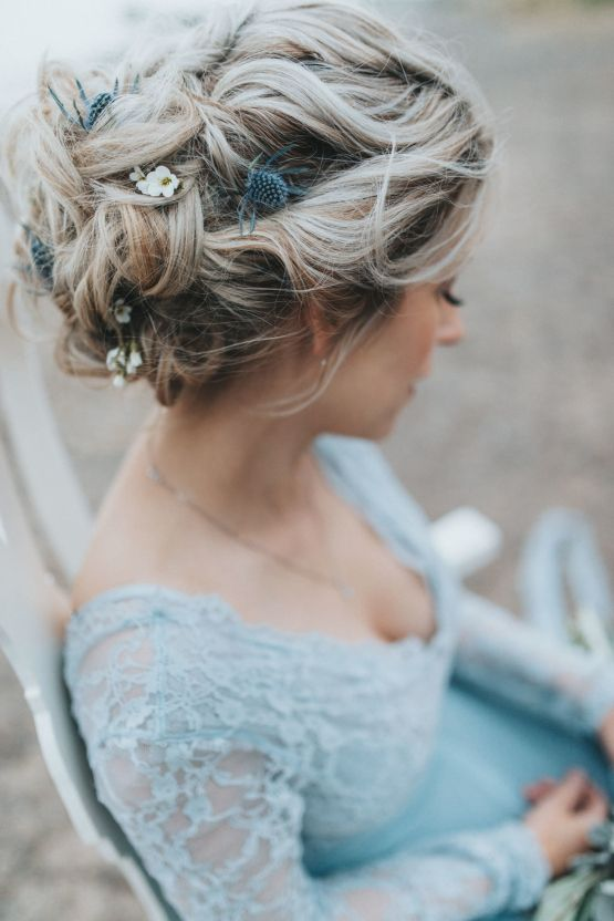 a wavy messy updo with blooms and thistles tucked in is ideal for a boho bride, for any season