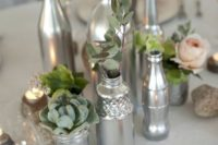 24 silver jars and bottles as vases for some herbs and blooms are great to compose a chic wedding centerpiece