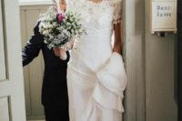 25 a romantic boho wedding gown with a lace applique bodice and a plain skirt with a train plus cap sleeves