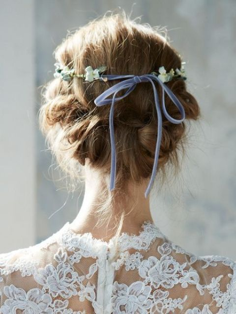 a wavy braided updo with a bump and a floral crown is great for a spring or summer Scandinavian bride