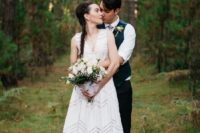 26 an ultra-modern white geometric wedding gown without sleeves and with a V-neckline