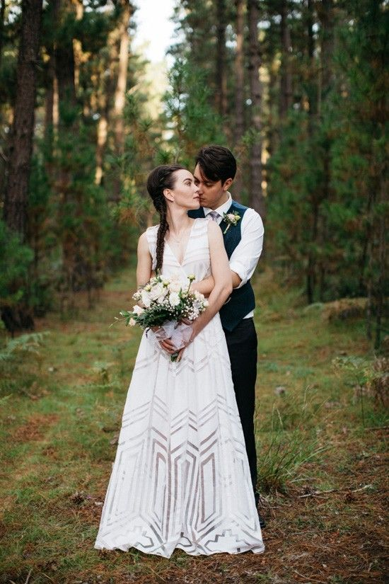 an ultra-modern white geometric wedding gown without sleeves and with a V-neckline