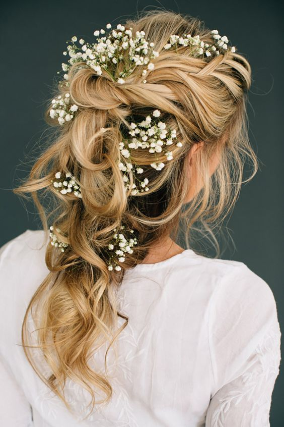 romantic tousled bridal braid adorned with baby's breath will be a nice option for a spring or summer Nordic bride
