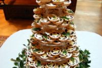29 make a tower of traditional for Christmas mince pies with cookie leaves and adorn the tower with real foliage
