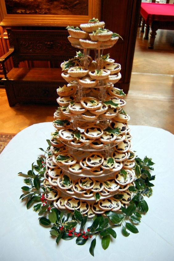 make a tower of traditional for Christmas mince pies with cookie leaves and adorn the tower with real foliage