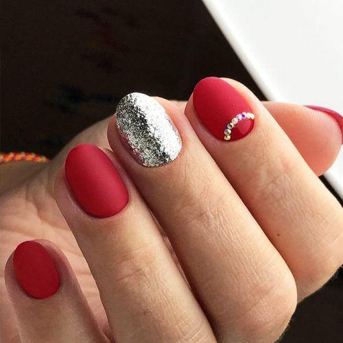 matte red nails, a silver glitter accent and a jeweled nail for a chic Christmassy look