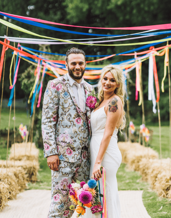 This colorful and bright rainbow wedding is a fully DIY affair with lots of florals and greenery