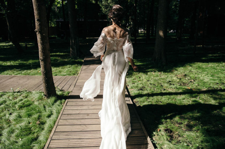 The bride was wearing a fantastic embroidered and embellished fitting wedding dress with a train and an illusion off the shoulder neckline