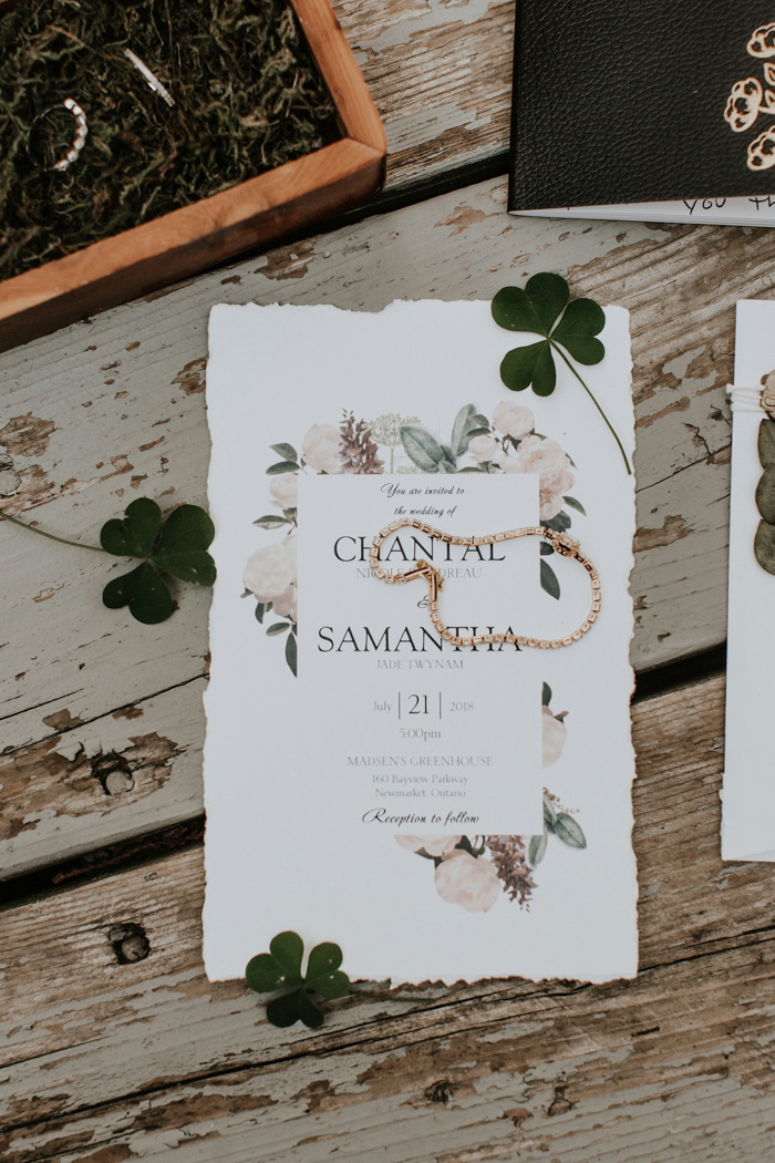 The wedding invitation suite was done with a raw edge and neutral blooms handpainted
