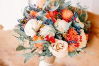 02 a cool textural wedding bouquet with creamy and coral blooms, with greenery and dried herbs