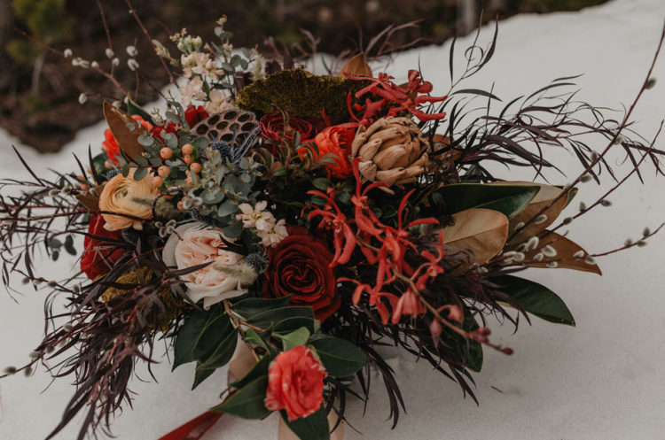 Her bouquet was a super textural and lush one done in dark hues and with grasses and berries