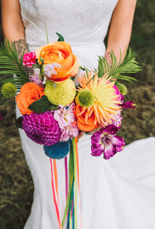 Her bouquet was colorful and vivacious, with a strong tropical feel, with pompoms and ribbons