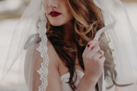 03 She added a veil with a lace and some stylish accessories, a red lip and matching nails to achieve a chic look