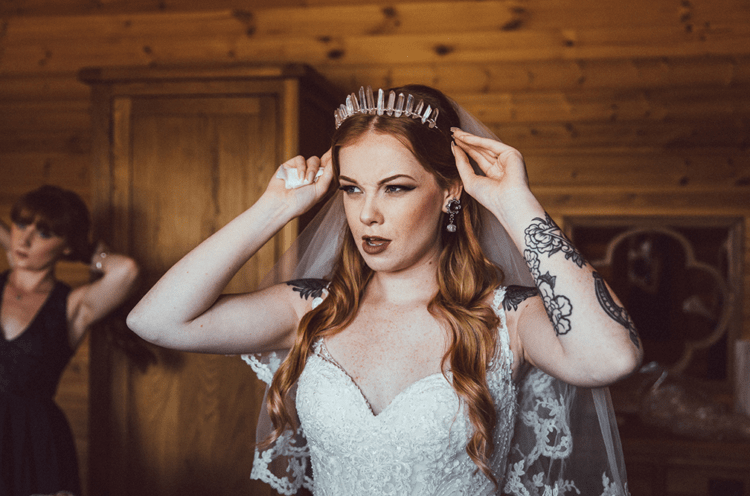 She was wearing a handmade crystal crown and a veil with a lace trim