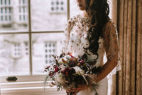 03 The bride was wearing a fitting modern wedding gown with an embellished shawl, long wavy hair and a dark lip