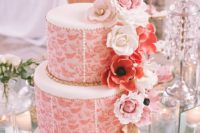 03 a gorgeous wedding cake in coral and white, with gold and blush sugar blooms on top