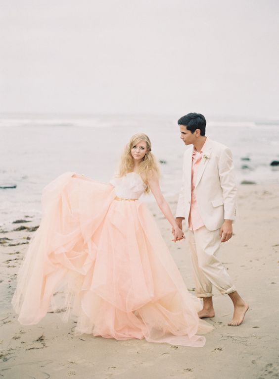 a unique wedding separate with a peachy pink layered full skirt and a neutral strapless top