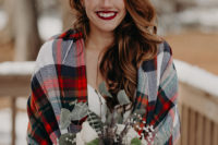 04 She covered up with a plaid coverup, with a classic Christmas print