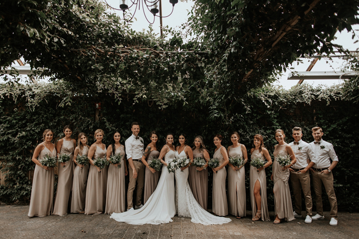The bridesmaids were wearign neutral draped maxi dresses and the bridesmen were rocking neutral pants, white shirts and sneakers