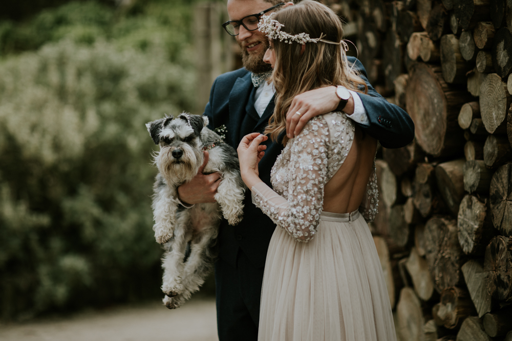 The groom was wearing a navy three piece suit, a floral bow tie and the couple's dog was a ring bearer
